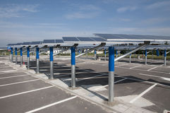 Renewable energy: solar panels. In a parking lot of a highway Italian. A solar panel (photovoltaic module or photovoltaic panel) is a packaged interconnected Stock Image