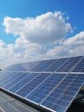 Renewable energy, solar panels. Renewable energy. Solar panels with sky background Royalty Free Stock Photo