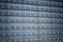 Renewable Energy - Solar Panels. Solar panels against the wall of modern warehouse Royalty Free Stock Photos