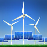 Renewable Energy - Solar Panels and Wind Power. High quality image of solar panels and wind turbine standing in a grass field against clean blue sky with Royalty Free Stock Photo
