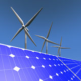 Renewable energy - solar panels and windmills Royalty Free Stock Photos