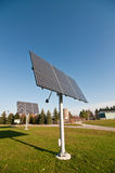Renewable Energy - Solar Power. Moveable solar panels stand in a park Stock Image