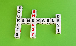 Renewable energy sources best. Text ' renewable energy sources are best ' with uppercase letters inscribed on small white cubes and arranged crossword style stock photo