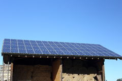Renewable energy. On top of a roof Stock Image