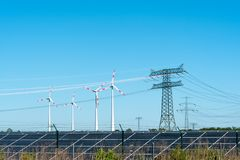 Renewable energy and transmission lines. Seen in Germany Royalty Free Stock Photography