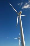 Renewable Energy. Wind generator on blue sky Royalty Free Stock Photography