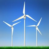 Renewable Energy - Wind Power. High quality image of wind turbine standing in a grass field against clean blue sky with clipping path Royalty Free Stock Images