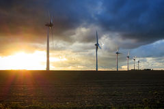 Renewable Energy Wind Power Windmill Turbines. Renewable alternative energy wind turbines farm with electric power generation windmills towers generating clean Stock Photos