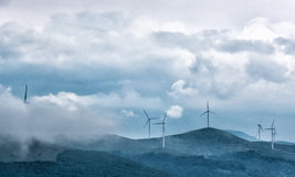 Wind turbines on a hill Stock Photo