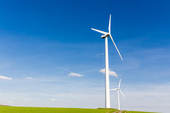 Renewable energy by wind turbine. Wind turbine with blue sky - renewable energy royalty free stock image