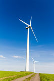 Renewable energy by wind turbine. Wind turbine with blue sky - renewable energy Stock Image
