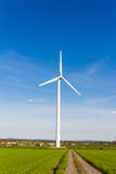 Renewable energy by wind turbine royalty free stock photography