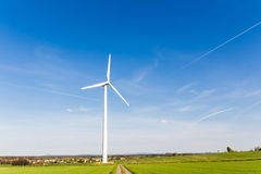 Renewable energy by wind turbine royalty free stock images
