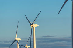 Renewable energy - wind turbines against a blue sky Stock Photo
