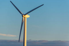 Renewable energy - wind turbines against a blue sky Royalty Free Stock Photography