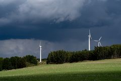 Renewable energy, wind turbines, biomass and forest. Royalty Free Stock Photos