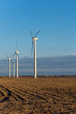 Renewable energy - wind turbines in rural hay fields Stock Photography