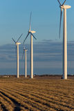 Renewable energy - wind turbines in rural hay fields Royalty Free Stock Photography