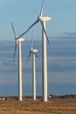 Renewable energy - wind turbines in rural hay fields Stock Image