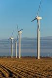 Renewable energy - wind turbines in rural hay fields Stock Photo