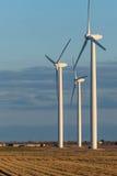 Renewable energy - wind turbines in rural hay fields Stock Images
