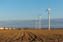 Renewable energy - wind turbines in rural hay fields Royalty Free Stock Photo