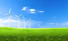 Renewable energy with wind turbines. Wind turbine in green hills. Ecology environmental background for presentations and websites. Beautiful wallpaper stock photography