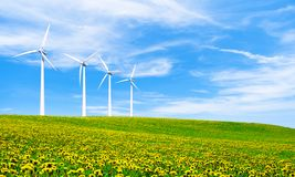 Renewable energy with wind turbines. Wind turbine in green hills. Ecology environmental background for presentations and websites. Beautiful wallpaper royalty free stock photo