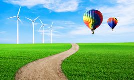 Renewable energy with wind turbines. Wind turbine in green hill. Ecology environmental background for presentations and websites. Beautiful wallpaper stock images