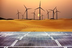 Renewable energy with windmills and solar panels in dessert at sunset stock photos