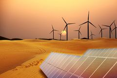 Renewable energy with windmills and solar panels in dessert at sunset stock photography