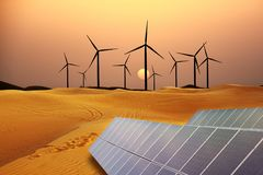 Renewable energy with windmills and solar panels in dessert at sunset. Renewable energy with wint tourbines and solar panels in dessert at sunset stock images