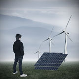 Renewable energy. Young woman looking at the landscape of renewable energy industry Royalty Free Stock Photo