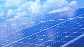Renewable green energy power solar cell install on roof. With sky reflection Stock Photo
