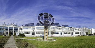 Renewable Green Energy Solar Panels. Panorama with The Transylvania Faculty -  on the Hill in Brasov. It has an entire solar panels system to produce green Stock Photo