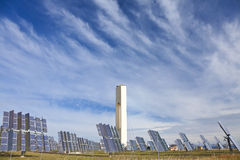 Renewable Green Energy Solar Tower & Mirror Panels. Solar tower surrounded by mirror panels harnessing the sun's rays to provide alternative renewable green Stock Photography