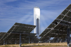 Renewable Green Energy Solar Tower & Mirror Panels. Solar tower surrounded by mirror panels harnessing the sun's rays to provide alternative renewable green Royalty Free Stock Images