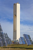 Renewable Green Energy Solar Tower & Solar Panels. Solar tower surrounded by solar panels harnessing the sun's rays to provide alternative renewable green Stock Image