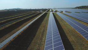 Large field of renewable solar energy. Shot on drone. Renewable solar energy. Generation of clean renewable solar energy. Alternative energy power field. Green stock video footage