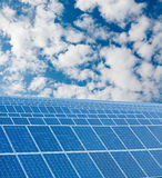 RENEWABLE SOLAR ENERGY. Solar panel and blue sky - renewable energy collecting Stock Image