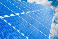 RENEWABLE SOLAR ENERGY. Solar panel and blue sky - renewable energy collecting Royalty Free Stock Images