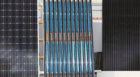 Renewable Solar Energy. Solar Water Heating and Photovoltaic Panel Renewable Energy Royalty Free Stock Photos
