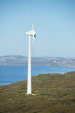Renewable Wind Energy Australia. Wind farm at coast of Southern Ocean in Western Australia, supplying clean renewable energy to town of Albany, summer sunny blue Royalty Free Stock Photos