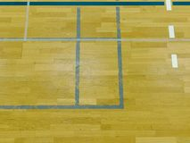 Renewal wooden floor of sports hall with colorful marking lines and new lacquered surface. White black red lines blue playfield in sports hall Stock Photo