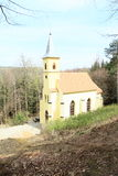 Renewed church in forest Stock Photography