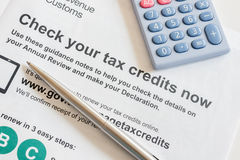 Renewing working tax credits. Renewing an annual British working tax credit and national living wage concept royalty free stock photo