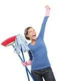 rengörande lycklig huskvinna Arkivfoto