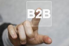 Rengöringsduk för symbol för knapp b2b för affärsman trängande direktanslutet Fotografering för Bildbyråer