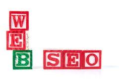 Rengöringsduk SEO Search Engine Optimization - alfabetet behandla som ett barn kvarter på whi Royaltyfri Fotografi