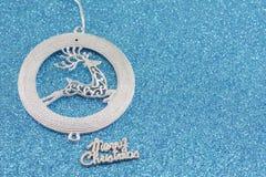 Renifera łańcuch na błękitnym tle Fotografia Stock